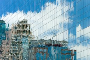 UK LL - building glass reflect city and sky - small